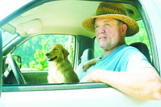 "<div class=""source"">Linda Ireland</div><div class=""image-desc"">Robert Enlow and his dog Zoe watched from the cab of a pickup truck as traffic zipped past on Bardstown Road.</div><div class=""buy-pic""><a href=""http://web2.lcni5.com/cgi-bin/c2newbuyphoto.cgi?pub=029&orig=robert%2Benlow.jpg"" target=""_new"">Buy this photo</a></div>"