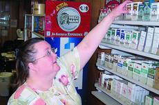 """<div class=""""source"""">Ron Benningfield</div><div class=""""image-desc"""">Employee Penny Childress said many of her customers at Smoketown II have voiced their opposition to the higher cigarette prices brought on by the tax that went into effect today.</div><div class=""""buy-pic""""><a href=""""http://web2.lcni5.com/cgi-bin/c2newbuyphoto.cgi?pub=029&orig=smoker%2Bpenny%2Bchildress%2Bsmoketown%2BII.jpg"""" target=""""_new"""">Buy this photo</a></div>"""