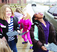 "<div class=""source""></div><div class=""image-desc"">Brandi Aubrey, Ayanna Humphrey and Ozariah Embree, students in Tracy Tharp's kindergarten class at Hodgenville Elementary School, caught snowflakes on black paper to see that no two snowflakes are alike. They also caught a few with their tongues.</div><div class=""buy-pic""><a href=""/photo_select/25922"">Buy this photo</a></div>"