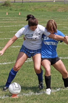 """<div class=""""source"""">Terry Sandidge</div><div class=""""image-desc"""">Seniors Meagan Williams, right, and Holly Crain battle for the ball in a recent Lady Hawks soccer practice.</div><div class=""""buy-pic""""><a href=""""/photo_select/2336"""">Buy this photo</a></div>"""