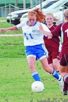 """<div class=""""source"""">Terry Sandidge</div><div class=""""image-desc"""">Lady Hawks soccer player Shelby Mouser scored the first point in the Monroe County game.</div><div class=""""buy-pic""""><a href=""""/photo_select/7751"""">Buy this photo</a></div>"""