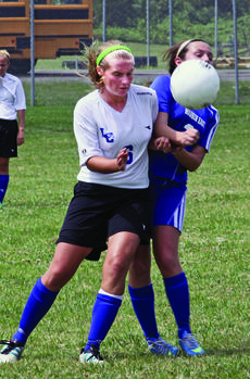 "<div class=""source"">Terry Sandridge</div><div class=""image-desc"">Junior midfielder Nichole Thomas muscled a Warren East player during the Lady Hawks' scrimmage.</div><div class=""buy-pic""><a href=""/photo_select/36561"">Buy this photo</a></div>"