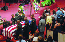 "<div class=""source"">Jill Pickett</div><div class=""image-desc"">Soldiers carry the casket of Spc. Nathaniel D. Garvin from the Stithton Baptist Church sanctuary to continue services at Kentucky Veterans Cemetery-Central on Friday in Radcliff.</div><div class=""buy-pic""><a href=""/photo_select/6040"">Buy this photo</a></div>"