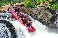 """<div class=""""source""""></div><div class=""""image-desc"""">It hasn't been all work and no play for Sydney Dobson, who signed up to work in Uganda for six months. Above, she and friends go river rafting. Dobson is in front, wearing the yellow helmet.</div><div class=""""buy-pic""""></div>"""