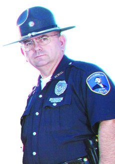 "<div class=""source"">Melanie Wells</div><div class=""image-desc"">Officer Mark Taulbee</div><div class=""buy-pic""></div>"