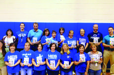 "<div class=""source"">Submitted photo</div><div class=""image-desc"">Sam's Club awarded 20 teachers from Hodgenville Elementary with $50 reward cards to purchase classroom supplies that will help students start the school year off right as part of the company's Teacher Rewards program. Hodgenville Elementary was drawn from schools submitted from nine school districts. Children cheered as their teacher was called out to receive their $50 reward card. Winning teachers are pictured: Nannette Lawler, Karyn Brey, David Edwards, Pam Rust, Kim Strange, Tracy Tharp, Mary Owen, Alan Thomas, Kathy Milby, Carol Routt, Carol Henry, Becky Hawkins, Patty Chaudoin, Sharron Butler, Daniel Risner, Mary Gomer, Peggy Williams, Traci Weaver, Drew Simpson and Renee Wright.</div><div class=""buy-pic""><a href=""/photo_select/31100"">Buy this photo</a></div>"