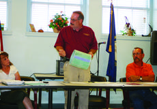 """<div class=""""source"""">Photo by Linda Ireland</div><div class=""""image-desc"""">Hodgenville Mayor Terry Cruse showed city council members the lining that is being used in sewer lines.</div><div class=""""buy-pic""""><a href=""""http://web2.lcni5.com/cgi-bin/c2newbuyphoto.cgi?pub=029&orig=terry%2Band%2Bthe%2Btube.jpg"""" target=""""_new"""">Buy this photo</a></div>"""