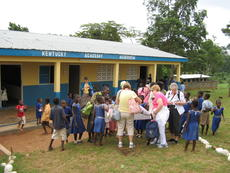 """<div class=""""source""""></div><div class=""""image-desc"""">Above, a group of Kentucky Extension Homemakers recently visited the African country of Ghana, where they brought donations to a rural village school. In honor of donors from this state, the kindergarten classrooms are called the Kentucky Academy in the v</div><div class=""""buy-pic""""><a href=""""/photo_select/4672"""">Buy this photo</a></div>"""