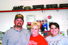 "<div class=""source"">Rebecca Roscoe</div><div class=""image-desc"">The Cornett's have become the most recent addition to the history of the building that houses their family business, The Crossings Family Restaurant. </div><div class=""buy-pic""><a href=""http://web2.lcni5.com/cgi-bin/c2newbuyphoto.cgi?pub=029&orig=three%2Bpeople.jpg"" target=""_new"">Buy this photo</a></div>"