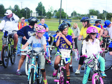 """<div class=""""source"""">Submitted photo</div><div class=""""image-desc"""">Cyclists for the Tour de LaRue prepared for their ride.</div><div class=""""buy-pic""""><a href=""""/photo_select/30522"""">Buy this photo</a></div>"""