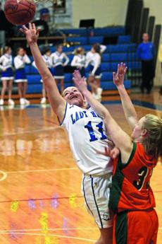"""<div class=""""source"""">Terry Sandidge</div><div class=""""image-desc"""">Lady Hawk Valerie Whitlock put up a shot amid some strong defense by Hart County. Whitlock scored 26 points for the game.</div><div class=""""buy-pic""""><a href=""""http://web2.lcni5.com/cgi-bin/c2newbuyphoto.cgi?pub=029&orig=valerie%2Bwhitlock%2BHART%2Bcolor.jpg"""" target=""""_new"""">Buy this photo</a></div>"""