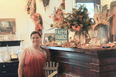 "<div class=""source"">Vanessa Hurst</div><div class=""image-desc"">Erica Vaughn stands next to a display of her Autumn floral arrangements and decorations. </div><div class=""buy-pic""><a href=""/photo_select/43309"">Buy this photo</a></div>"