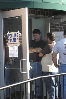 """<div class=""""source"""">Ben Sheroan</div><div class=""""image-desc"""">The Hodgenville West precinct stayed busy all day Tuesday with a line winding through the basement of City Hall and out the door. LaRue County officials report a larger than normal turnout for the election.</div><div class=""""buy-pic""""><a href=""""http://web2.lcni5.com/cgi-bin/c2newbuyphoto.cgi?pub=029&orig=vote%2Bline.jpg"""" target=""""_new"""">Buy this photo</a></div>"""