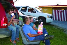 """<div class=""""source"""">Photo by Linda Ireland</div><div class=""""image-desc"""">John and Kim Wathen and family of Magnolia enjoyed a movie under the stars at Skyline Drive-In. </div><div class=""""buy-pic""""><a href=""""/photo_select/29629"""">Buy this photo</a></div>"""