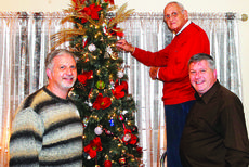 """<div class=""""source"""">Submitted photo</div><div class=""""image-desc"""">W.D. Burden adjusts an ornament on his Christmas tree at his condo in Louisville while sons Troy, left and Jayme look on. Burden underwent a liver and kidney transplant Sept. 13.</div><div class=""""buy-pic""""><a href=""""/photo_select/31992"""">Buy this photo</a></div>"""