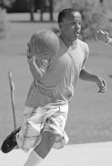 """<div class=""""source"""">FELICIA MARIE GRAY</div><div class=""""image-desc"""">Brandon White brought the ball to the goal during Another Level Basketball Camp.</div><div class=""""buy-pic""""><a href=""""/photo_select/35750"""">Buy this photo</a></div>"""