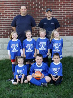 Members of Coach Dale Hunters U6 soccer team are front from left, Lilli Gibson, Jacob Hunter, Skyler Sosa; middle, Lexi Wheeler, Haylee Ramsey, Daniel Ard, Abby Lester; back, Dale Hunter and Brandon Ramsey, coaches.