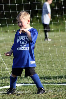 Daniel Ard, a U6 player, &quot;gets down&quot; on the field.
