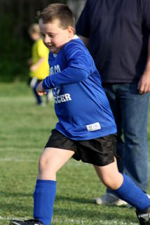 Jacob Hunter kicks the ball downfield in U6 play.