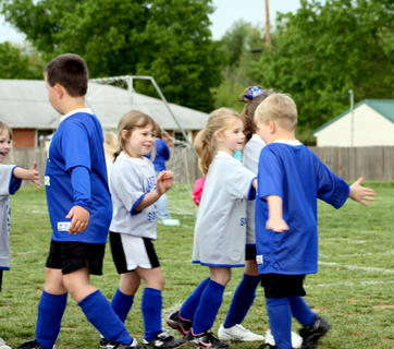 U6 players congratulate each other after a game.