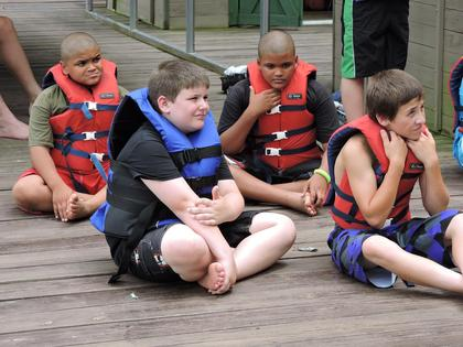 Demetrius Richardson, Brayden McCandless, Deon Richardson and Sebastian Perkins at the lakefront canoeing class.