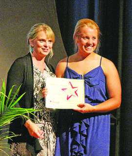 LaRue County High School senior Brigette Skaggs, right, received a scholarship and early admission into the dentistry program at the University of Louisville. The certificate was presented by Jo Newton.