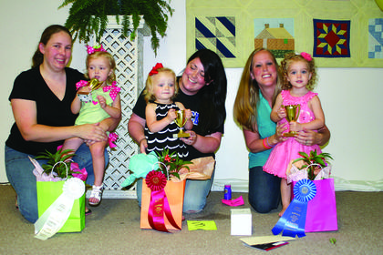 "Winners of the Most Beautiful Baby Contest for girls, ages 1-2, are from left, second, Kampbell McDowell, daughter of Brandon and Kaelyn McDowell of Hodgenville; winner, Ellie Fuller, daughter of Jennifer Fuller of Hodgenville; and third, Alexia ""Lexi"" Yates, daughter of Jimmy and Angie Yates of Buffalo."