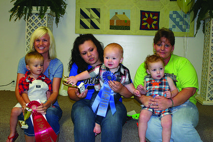 Winners of the Most Beautiful Baby Contest for boys, ages 1-2, are from left, second, Edison Durrett, son of Blake and Whitney Durrett of Hodgenville; winner, Braydon Ray Milby, son of Katlin and Dalton Milby of Hodgenville; and third, Ethan Lee Rooks, son of Chris and Stephanie Despain of Buffalo.