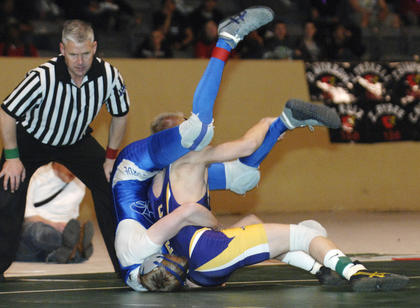 LaRue County&#039;s Nick Paden tries to roll out of a pin attempt by Campbell County&#039;s Garth Yenter during the 120-pound championship match Saturday in the 2012 KHSAA State Wrestling Championships at Alltech Arena in Lexington.