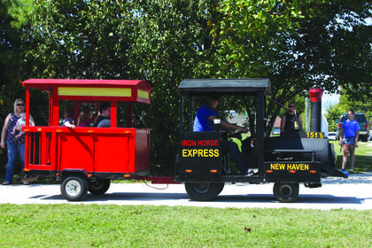 Kids take rides on a mini train during the 2017 Rolling Fork Iron Horse Festival in New Haven Saturday.