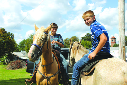 Pictured from left to right are Logan and Cody Bareley riding their horses Peaches and Leroy around town after riding in the 2017 Rolling Fork Iron Horse parade.