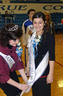 Katie Barros, Homecoming Queen, crowned by last year's queen, Angelia Whitlock.