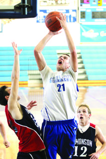 Junior forward Tyler Howell put up a shot for the Hawks.
