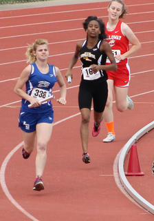 Amanda Brewer ran in the 4x400 and 4X800 during the State Track Meet at UofL in May.