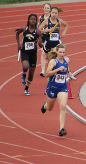 Nichole Thomas ran in the 4X800, 4X400 and jumped in the triple jump during the State Track Meet at University of Louisville in May.