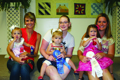 Winners of the Most Beautiful Baby Contest for girls, ages 2-3, are from left, third, Kinzligh Brooke Hack, daughter of Jami and Heather Hack of Hodgenville; second, Natalie Sophia Wheeler, daughter of Nathan and Megan Wheeler of Hodgenville; and winner, Audrie Faith Roberts, daughter of Ben and Angela Roberts of Hodgenville.