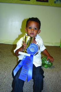 Winner of the Most Beautiful Baby Contest for boys, ages 2-3, was Justus Embree, son of Mitchell and Kayla Embree of Buffalo.