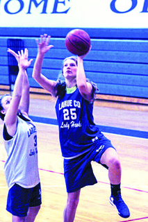 Junior center Allison Evans put up a shot for the Lady Hawks.
