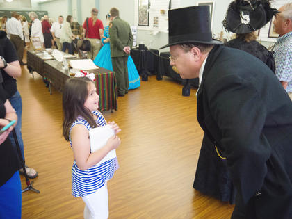 Alyssa Levee gets a chance to talk to Teddy Roosevelt at the reception held in the Community Room of the Lincoln Museum on Saturday July, 16.