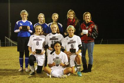 Lady Hawks, back from left, Nichole Thomas, Rachel Wolf and Abby Modrowsski were named to the All-Tournament Team for district play.