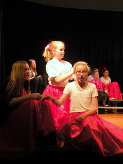 "Daisy Graham, Chloe Sandidge, Rachel French singing ""Beauty School Drop-out"" from Grease"
