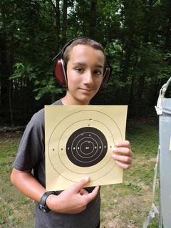 Chase Hines with his target at rifle class.