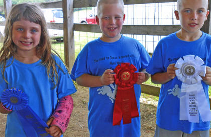 The winners of the 4-H Rabbit Showmanship Cloverbuds competition for ages 5-8 are from left, Amy Hurley of Breckinridge County, first;  Devin Rock of LaRue County, second place; and Jamie Grimes of LaRue County, third.