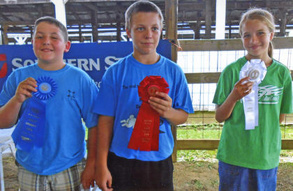 Winners of the 4-H Rabbit Junior Showmanship competition for ages 9-13 are from left, Cole Nash of Breckinridge County, first; Zachary Duvall of LaRue County, second; and Abigail Sallee of LaRue County, third.