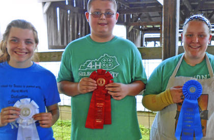 Winners of the 4-H Rabbit Senior Showmanship competition are from left, Sarah Duvall of LaRue County, third; Travis Van Vactor of Nelson County, second, and Michaela Rock of LaRue County, first.