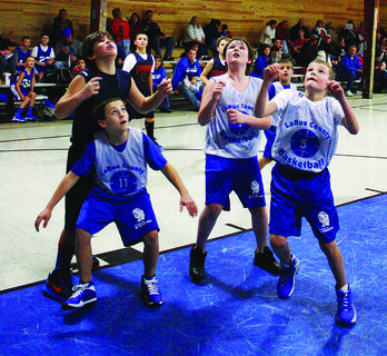 The LaRue County AAU team competed in the second annual Kentucky Bombers Invitational over winter break in Grayson County. Above, from left, Sebastian Perkins, Kaleb Graham, Daniel Snodgrass (background) and Evan Morris play the Grayson Cougars. The Cougars won 34-17.