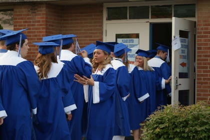 Sydney Dobson spoke with her fellow graduates before entering the gym.