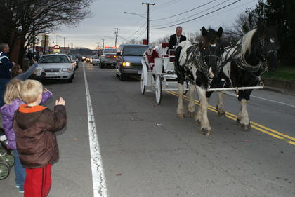Eli Greer waved at Santa in the New Haven Christmas Parade.