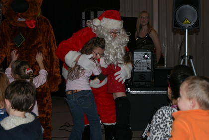 Trinity Leasor gave Santa a hug.