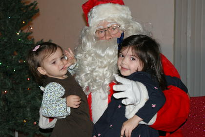 Lucy and Claire Higginbotham visited with Santa after the magic show.